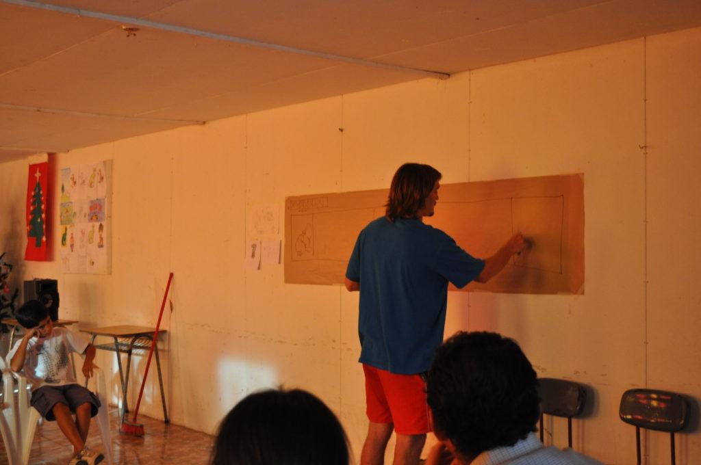 Reunión y conservatorio con vecinos para definir el trabajo del mural. Población Ana Rodriguez de Lobo, Villa Alegre. febrero 2012.